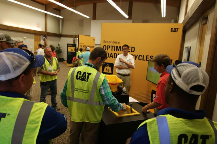 Caterpillar Representative Jay Ripp and Gregory Poole Sales Representative Josh Mann showed customers the benefits of the new payload technology.