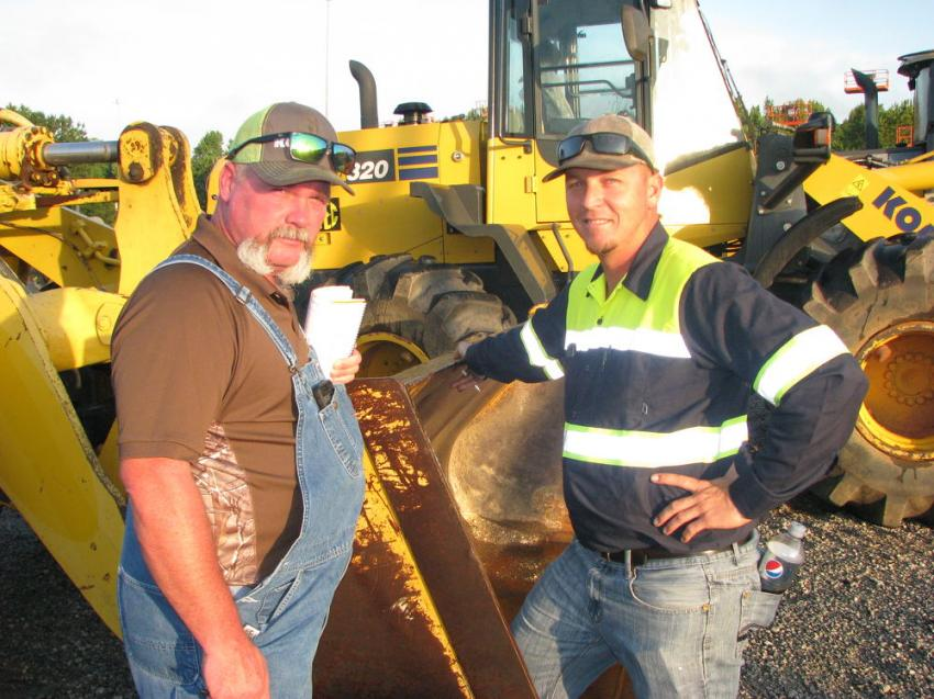 Checking out the wheel loaders in the sale lineup are John Switzer (L) J. Switzer & Sons Equipment, Tampa, Fla., and Brandon Weaver of Strategic Heavy Equipment, also of Tampa.