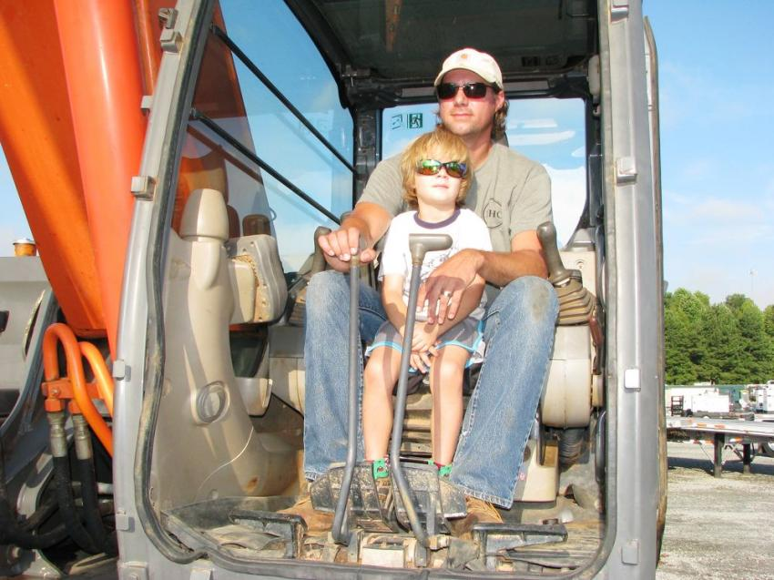 Demolition contractor, Thomas Bush and his five-year-old son, Dillon, of the Henry Hudson Company, Valley, Ala., were out looking for a Hitachi Zaxis 350 to buy.