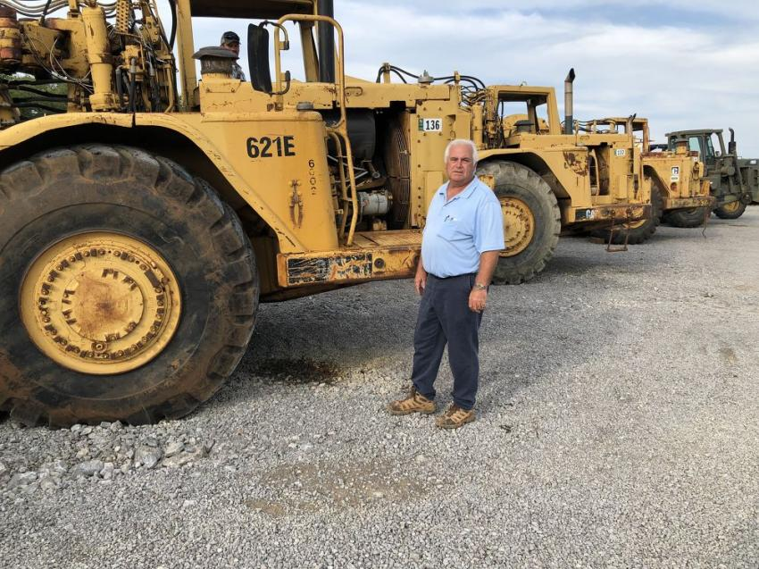 Ted Hunsaker of Keck Enterprises, Knoxville, Tenn., looked over this Cat 621E scraper and liked what he saw in the machine.