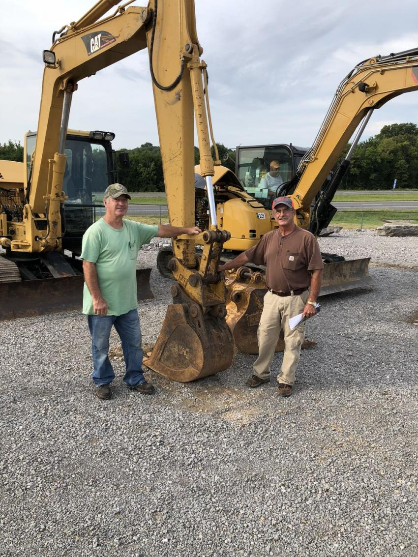 James Darell (L) of Hesson Backhoe in Pleasant Shade, Tenn., and Larry Clark of Clark Construction in Lafayette, Tenn., were checking out the equipment up for bid.