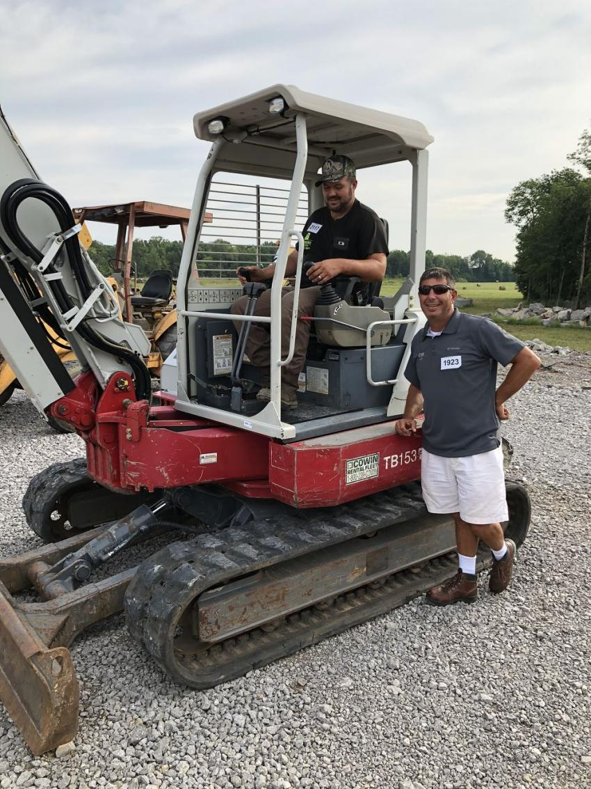Larry Tabor (L) and Joe Asher of Kentucky Stream Restoration in London, Ky., tried out several mini-excavators and planned to bid on this Takeuchi machine.