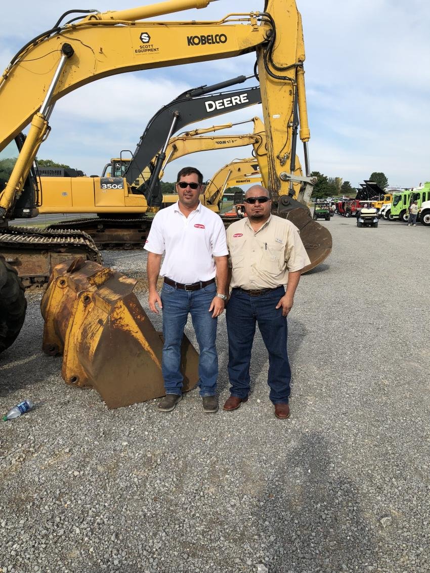 Jason Snider (L) and Sergio Morales, both of SniderEquipment.com in Jackson, Tenn., looked over several machines and found a couple they were interested in bidding on.