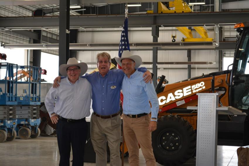 Rinny Johnson (C), vice president of ASCO Central Texas, presented Case Construction Equipment executives Michel Marchand (L) and Carl Gustaf Goransson with cowboy hats in appreciation of their company's support.