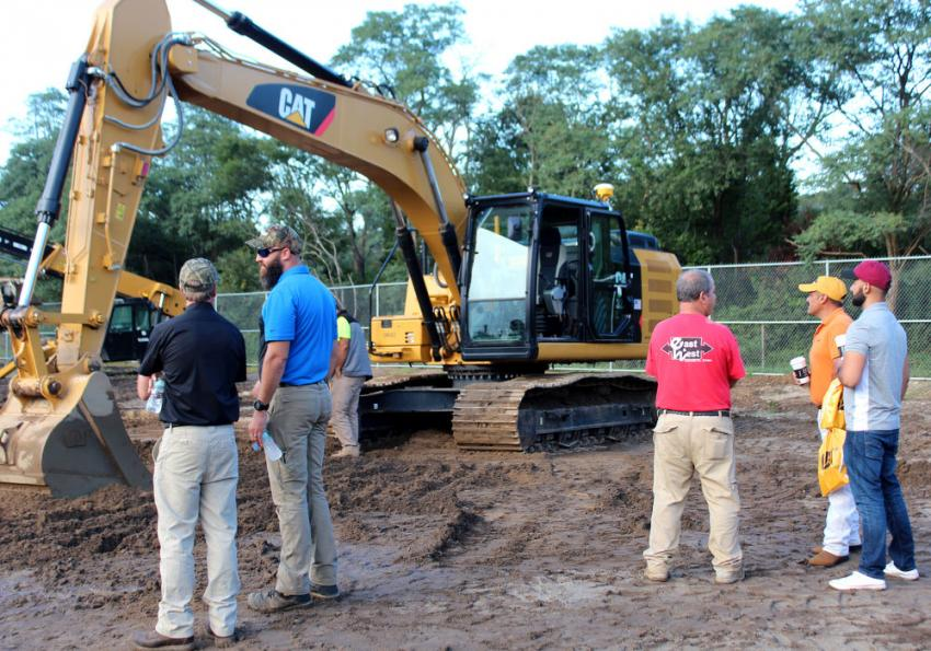 The Cat 323 excavator with Cat Grade Control, Auto Assist and 3D GPS kit drew a big crowd.