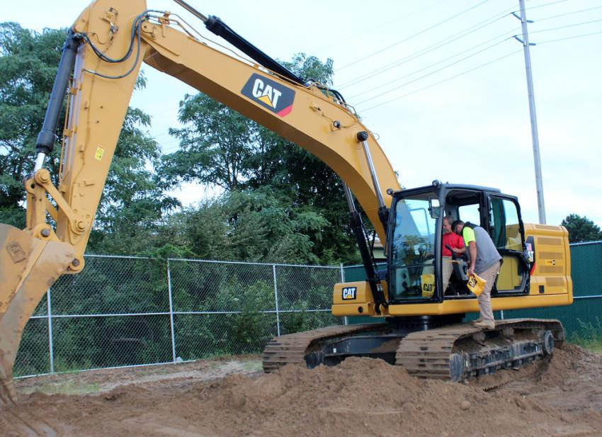 Jack Bedrosia of C & L Concrete gets in the seat and sees for himself the benefits of the latest Cat 320 next generation excavator.