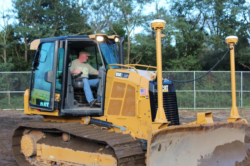 John Kelly of Kelco Construction runs the Cat D5K XL with 3D GPS to see first-hand how this technology can improve his productivity and efficiency.