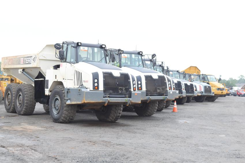 Terex TA300 artic trucks are lined up and ready for new owners.