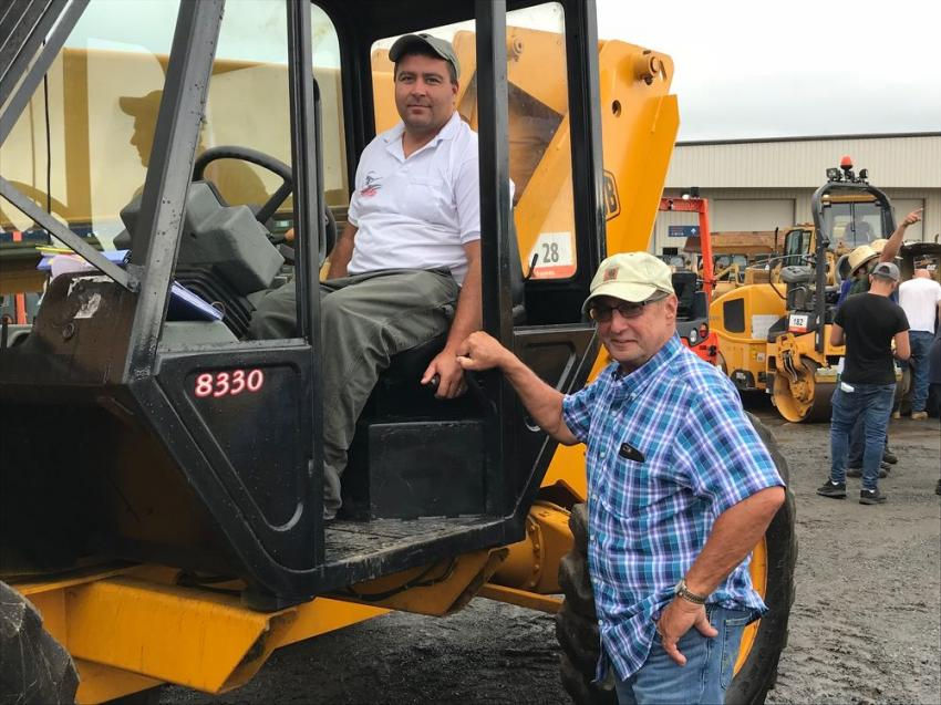 Matt Morgan (L) and Don Irelan of Coastal Delmarva Masonry, Harbeson, Del., look over a JCB telehandler.
