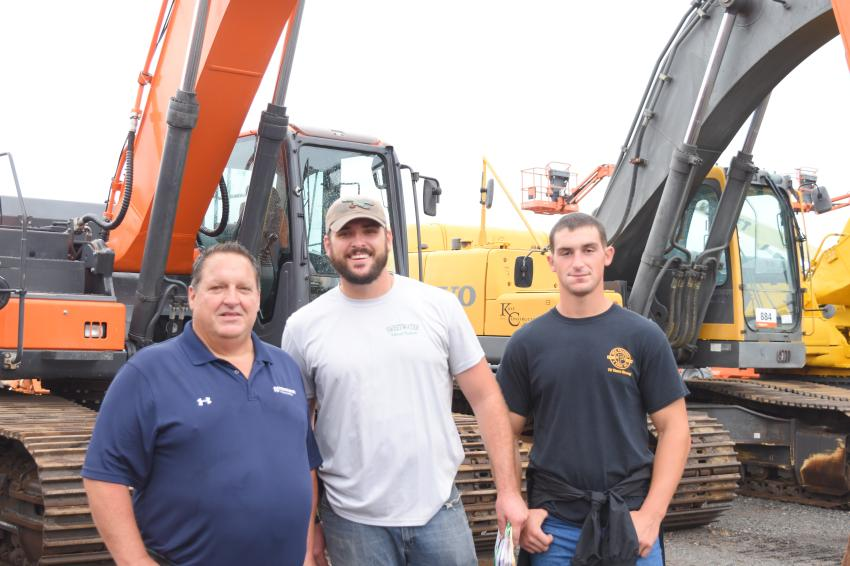 Greg Falcone (L), owner of Nick Falcone & Sons, Media, Pa., his son Greg Falcone Jr. (R), project manager, and JJ Lowden, operations manager of Sweetwater Natural Products, Chester Springs, Pa., are in search of deals at the sale.