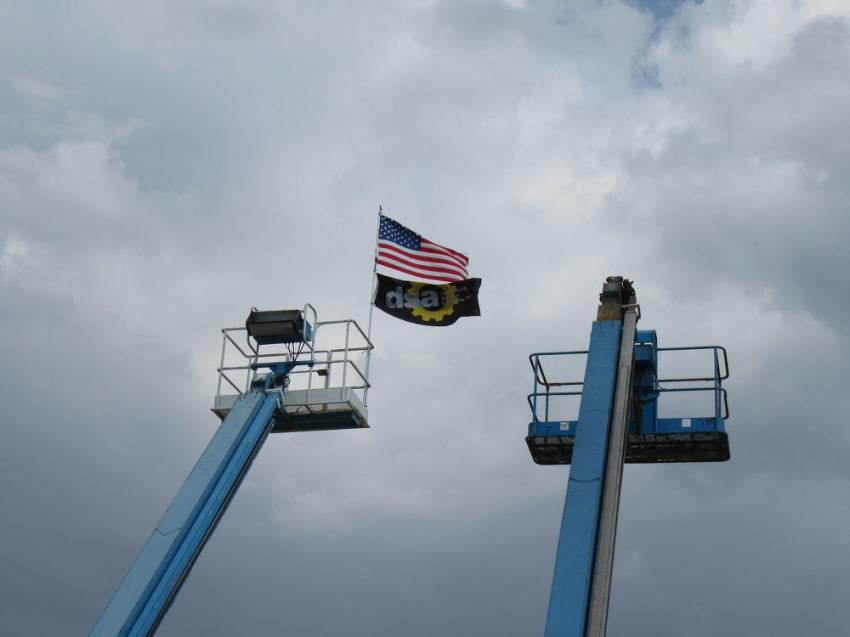 The stars and stripes and the Don Smock Auction Company banner flew high over the equipment yard during the auction.