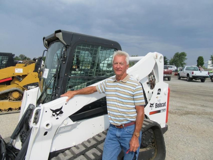 Jim Galloway of Galloway Farms, who had a few pieces in the sale, checks out a Bobcat T650 compact track loader at the auction.