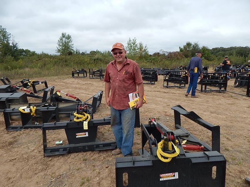 Rick Anderson, owner of Lakes Mechanical, Chisago City, Minn., a CEG subscriber for 15 years, looks over the tree shears and grapples. Anderson said he loved CEG's articles, products and reviews at the auction.
