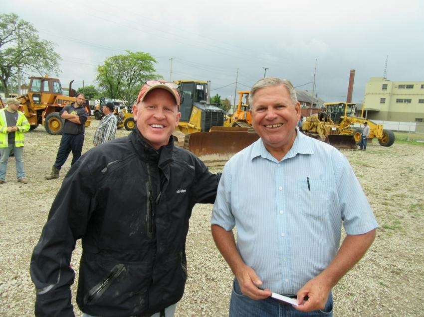 In for the auction from Massachusetts, Richard Wojtkowski (L) of Pittsfield Lawn and Tractor talked equipment with Gibson Machinery's Chuck Ruggles.