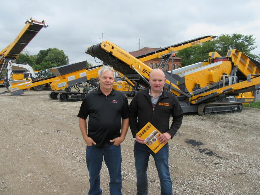 With a new Barford equipment display at the auction site, David Allen (L), president of Ohio Barford dealer A-Equip Pro LLC, is joined by Barford General Manager Stephen Murphy, who was in from Ireland.