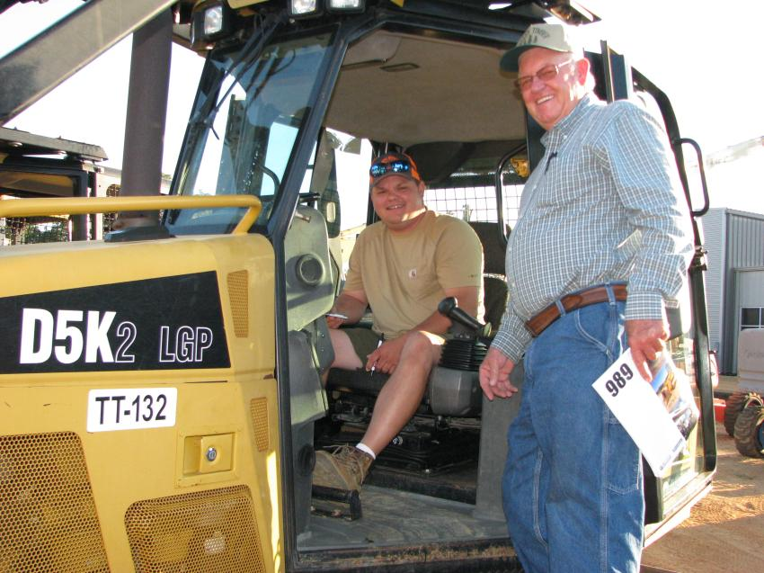 Checking out one of the dozen Cat D5K2 dozers about to go across the ramp are Curtis Chisenhall (L) and Jimmy Hester of Valley Timber, Fort Payne, Ala.