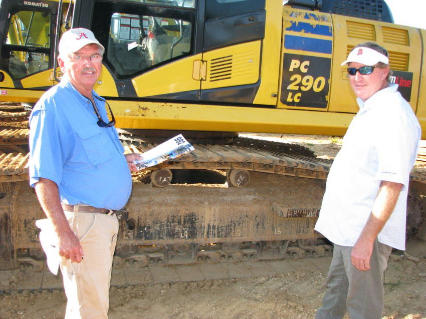 Discussing their thoughts on a Komatsu PC290LC excavator are Wendell Latham (L) and Mike Thomas of M.D. Thomas Construction, Orange Beach, Ala.