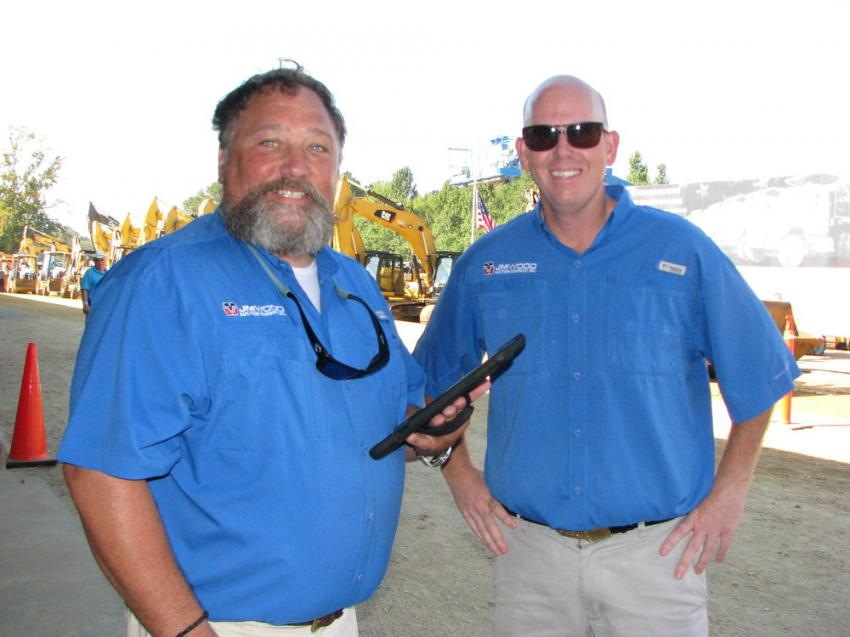 Wheeler Johnson (L), owner of Pungo Machine, Pantego, N.C., comes back to his auctioning roots and provides a helping hand to Russ Wood and the staff of JM Wood for this sale.
