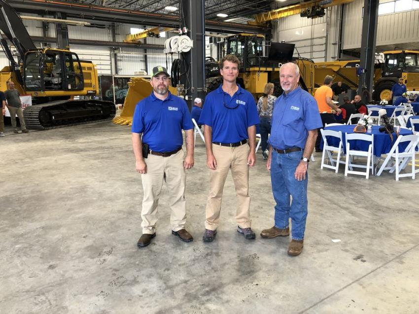 (L-R): Stephen Culp, Todd Anderson and Jerry Norris stand in front of the John Deere 345G, a zero tailswing 80,000-lb. excavator; a John Deere 944K, a 10-yard loader; and the John Deere 410E, a 40-ton artic truck … all in the 20,000-sq.-ft. service area.