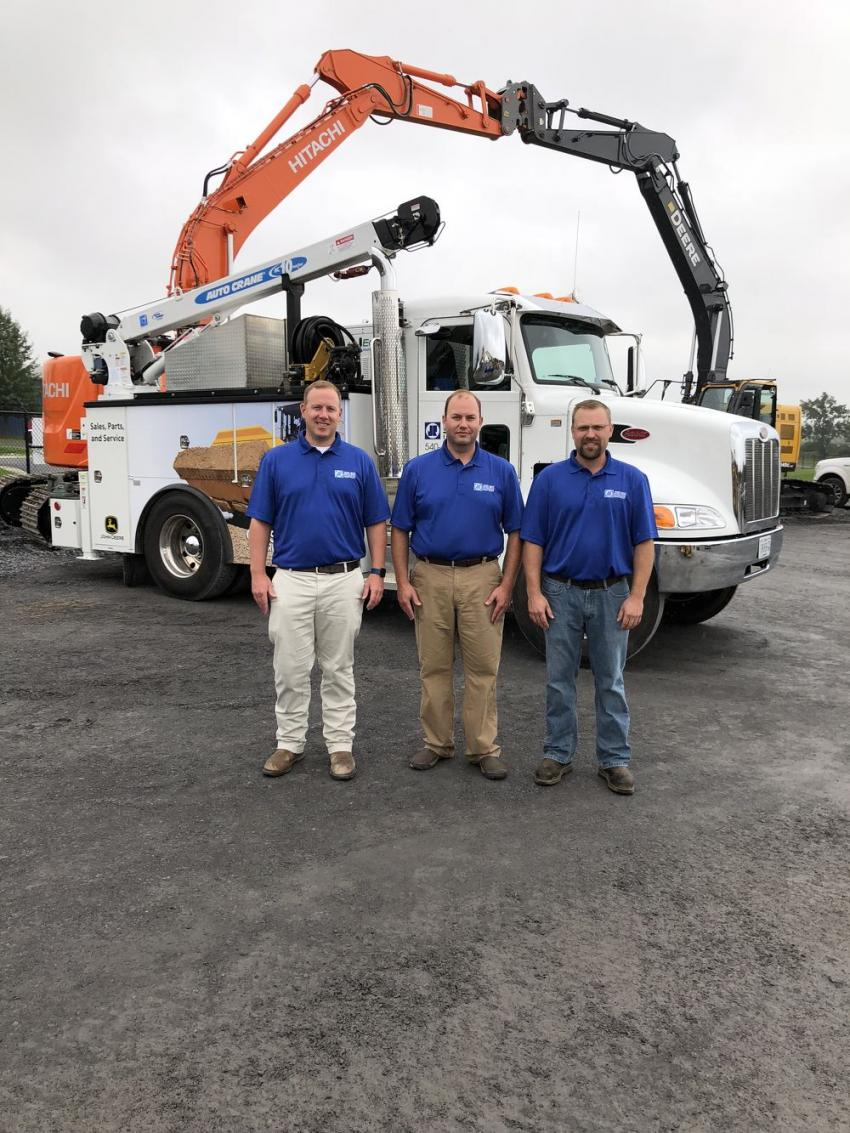 (L-R): Zan Erskine, Doug Roan and Brad Burruss, are the managers in Fishersville, Winchester and Manassas. Among the three locations, the company has 31 full-service vehicles like the one behind them.