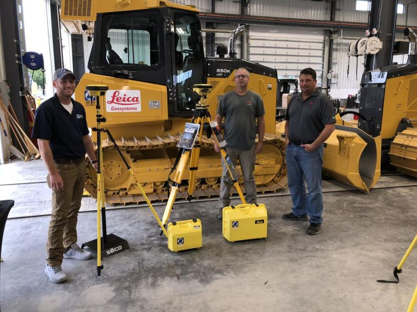 (L-R): Sam Mewshaw of James River Equipment and Dwayne Sawyer and Brandon Faulkner, both of Leica Geosystems, discuss the Leica 70T Tilt Rover that offers many easy-to-use functions.