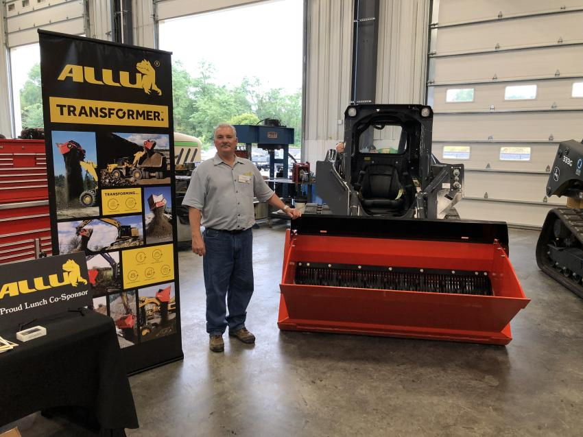 Dale Mickle of ALLU Group Inc. showcased his company's DL Series attachment, which attaches to a skid steer loader or mini-excavator to screen, crush, blend or separate