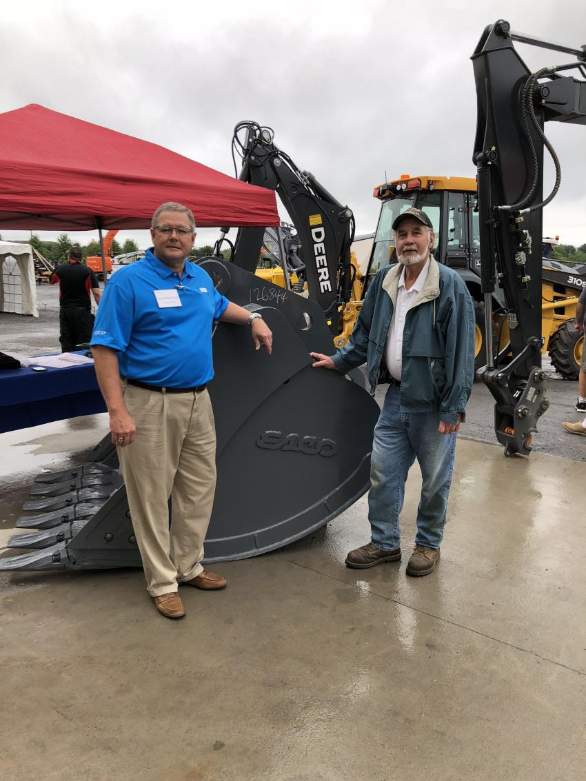 With the ESCO 54-in. bucket for a John Deere 350 excavator are Dave Nightlinger (L), ESCO, and Jay Corbalis of Corbalis Construction & Engineering, Berryville, Va.
