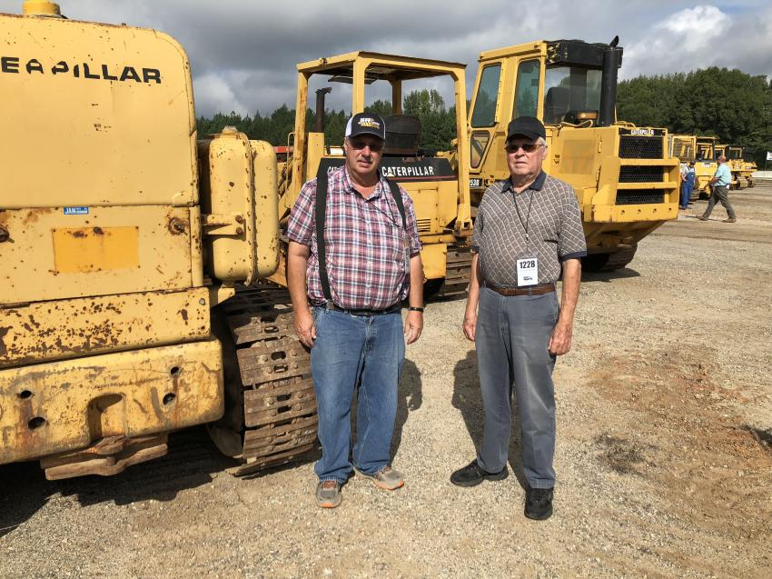 Jeff Thomas (L) and Ray Brown, both of  Thomas Grading in Spartanburg, S.C., plan to bid on the crawler loaders.
