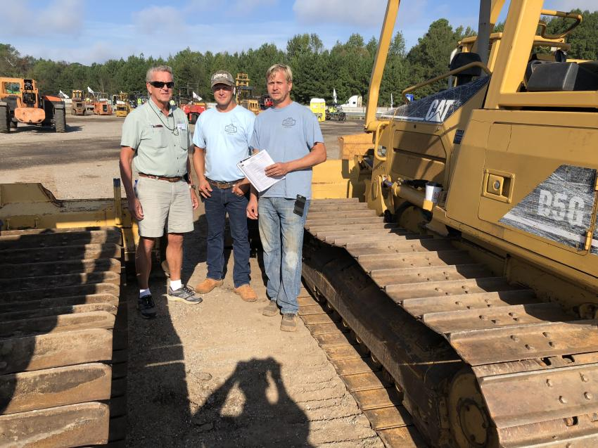 (L-R): Juha, Mike and Seth Parkkonen, all of Ashmore Homes Inc. in Greer, S.C., look over dozers they'd like to use on a couple of upcoming projects.