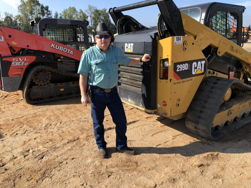 Mike Greer of Eagle Landscaping & Grading in Greer, S.C., looks over the Kubota and Cat compact track loaders on which he plans to bid.