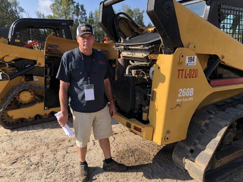 Roger Bradley of Cody Express in Easley, S.C., looks over the engine and checks the fluids on a Cat 268B compact track loader.