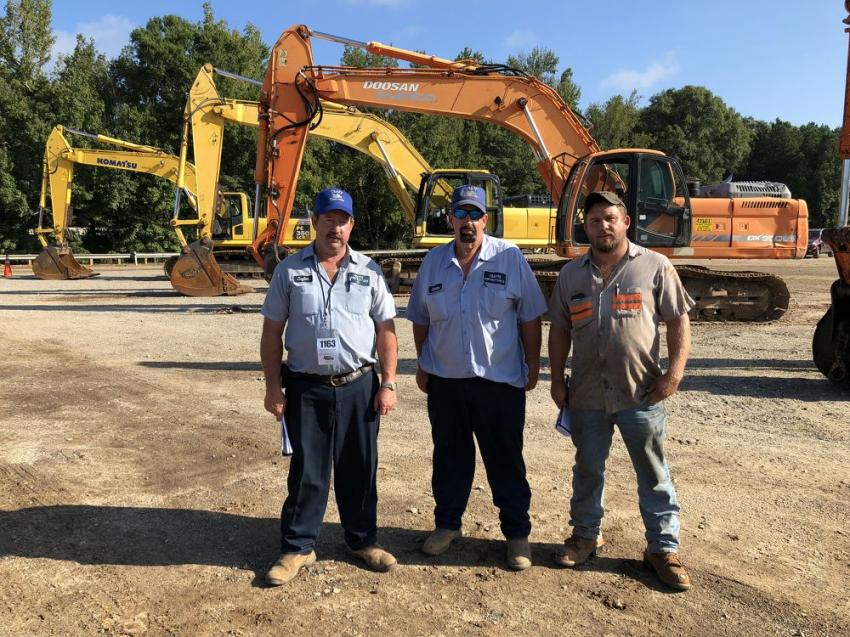 The auction included Doosan, Cat, Komatsu and Link-Belt excavators. Looking them over (L-R) are Clayton and Coleman Trapp of Trapp Construction in Blythewood, S.C., and Heath Humphries of Wood Haulers in Greenwood, S.C.