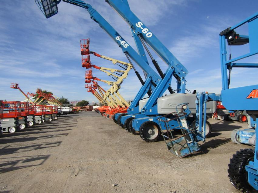 An array of Genie S-60 boom lifts are on display for buyers to choose from.