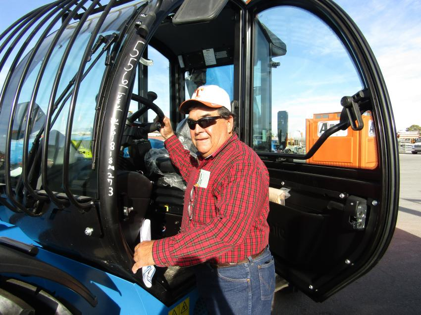 Ruly Holguin of Ruly's Mobile Welding, drove from West Texas to look for pieces of used equipment for his business. Holguin inspected this Genie telescopic forklift before bidding started.