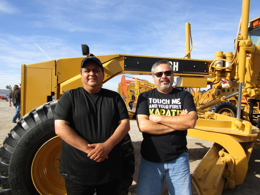 Hector Ramos (L) and Luiz Labastida of CKB Construction of Baha, Mexico, drove overnight to attend their first auction. They were looking for low-hour heavy equipment for their growing business. This Cat motor grader was one of the first pieces of equipment up for consideration.