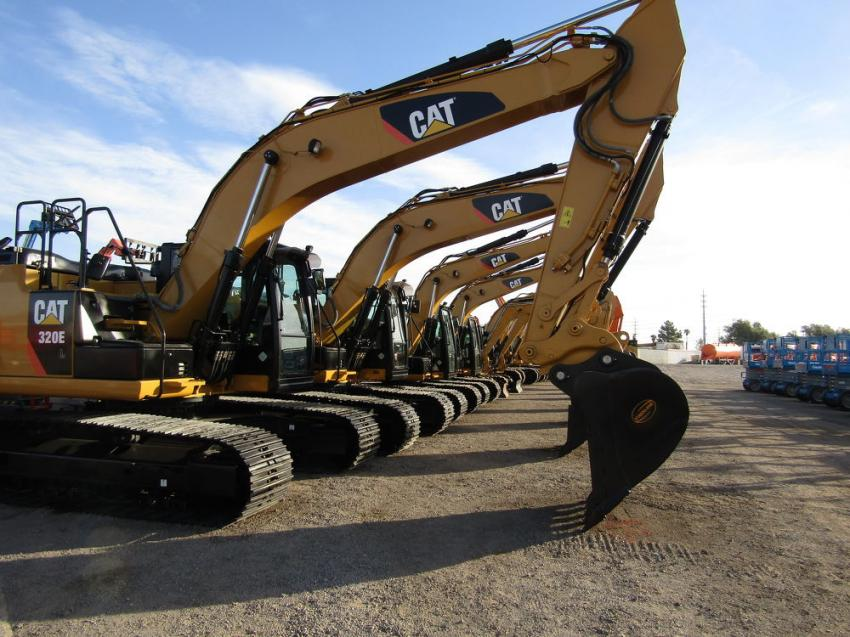 Caterpillar excavators await their turn on the auction block.