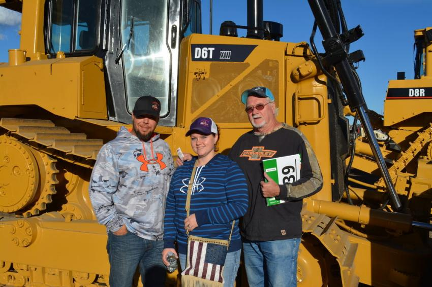 (L-R): Josh and Heather Olson of J Hangin H Trucking, Lingle, Wyo., were in Denver with Peter Chiristeleit of Lead Dog Trucking, also of Lingle, Wyo. The Olsons and Chiristeleit were each hoping to go home with a Cat D6T dozer.