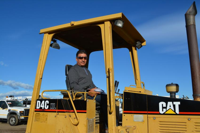 Victor Zubia checks out this Cat D4C XL dozer he hopes to put to use in his business, Zubia's Stone, of Rocky Ford, Colo.