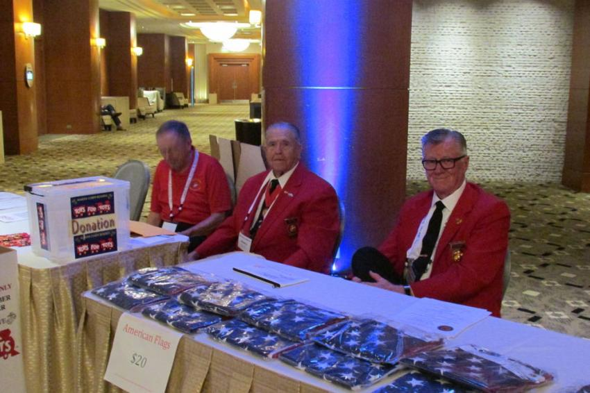 (L-R): Bill McCrudden, Ronald Powell and Mo Loveland man the Toys for Tots table just outside the exhibit area.
