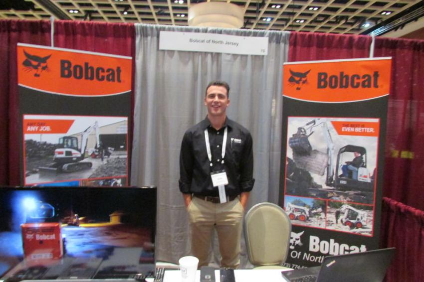 Sean Kunkel, Bobcat specialist, Bobcat of North Jersey, stops for a picture during a rare quiet moment at the UTCA Convention.