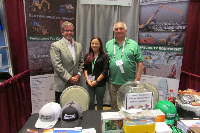 (L-R): Harry Rice, sales representative; Kim Bruno, marketing communications specialist, and Steve Izzi, New Jersey crane manager, all of Hoffman Equipment, pose for a photo.