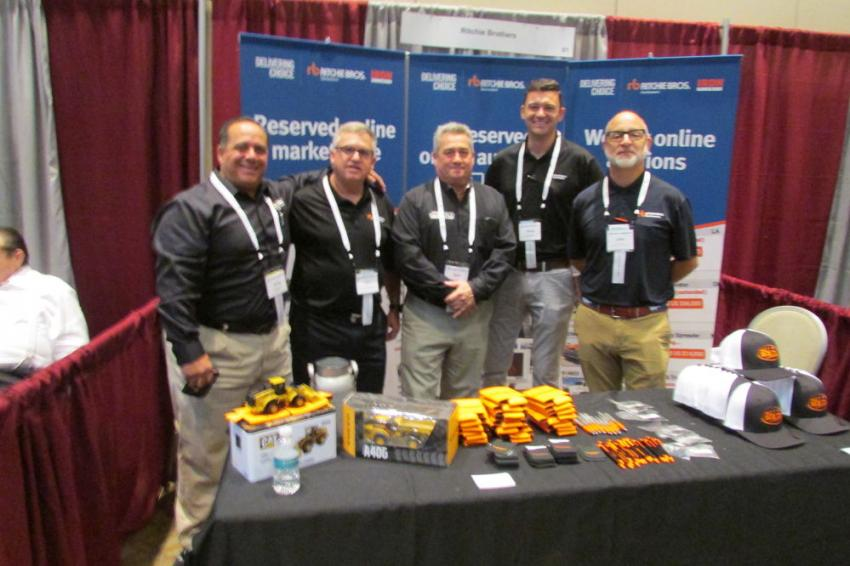 At the Ritchie Bros. booth, Fred Vilsmeier, auctioneer (second from L), Adam Byrne, territory manager (second from R) and Gary King, territory sales manager (far R) pose with JESCO colleagues Steve Mazzarella (far L), C&F sales representative, and Rick England, territory manager.