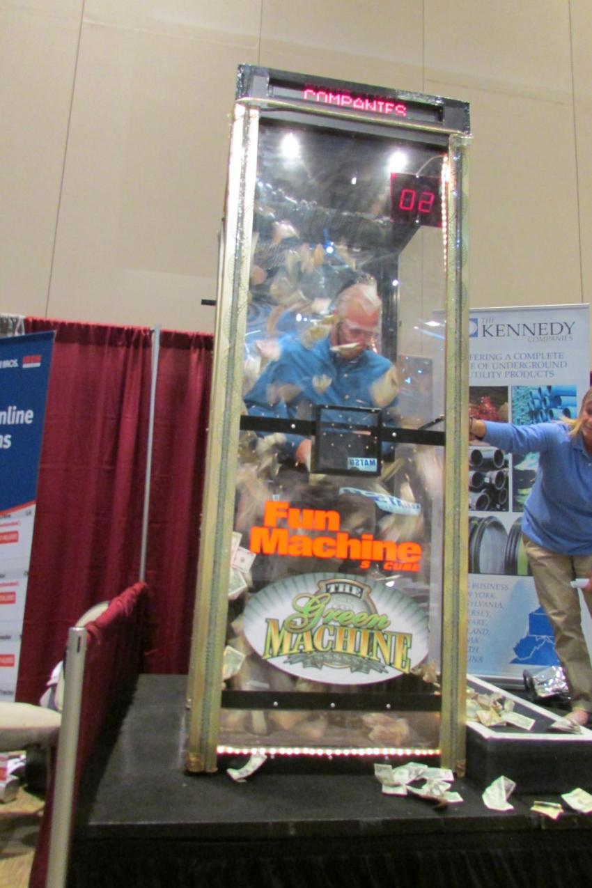 Gary Aulffo, director of water treatment at Zack Painting Company Inc., tries his hardest to grab as much cash as he can in the fun machine. He stepped out of the booth with $96.