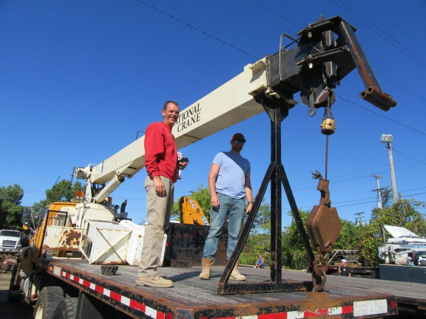 Bill Estright (L) of Masonry Contracting Inc. and Shannon Lindsco of Pit Concrete Masonry Ltd. get a closer look at a National Crane boom truck at the auction.