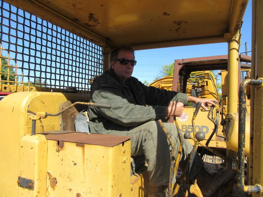 Jeff Rice of Rice Construction tries out a Cat dozer at the auction.