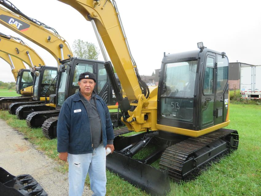 Alex Rodriguez of Rodriguez Construction looks over the excavators at the Oct. 5 auction.