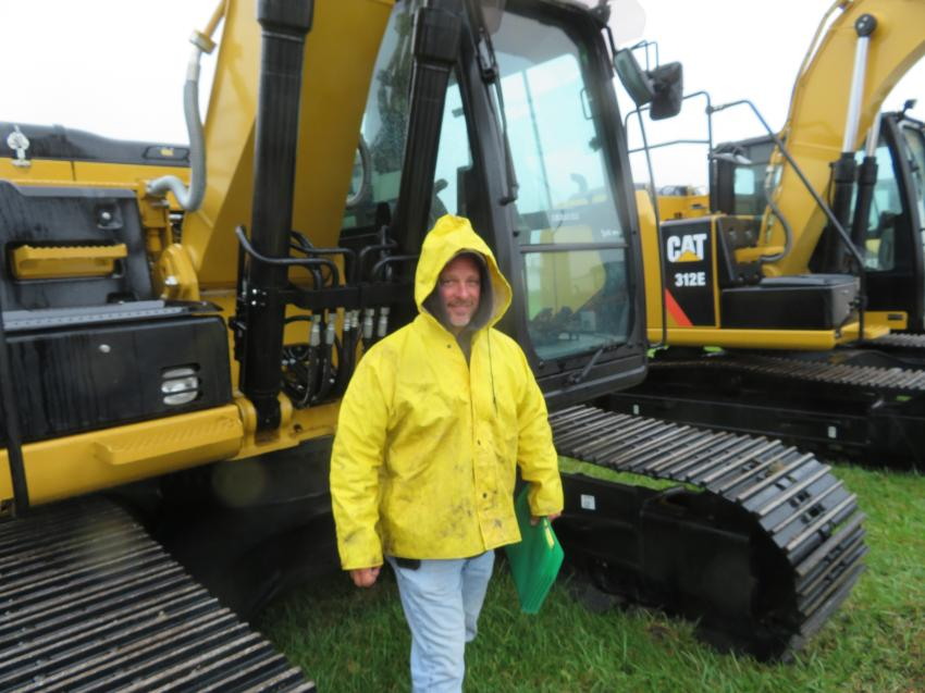 Having a look at a Cat 320E excavator is Shawn Spiess of Spiess Construction.