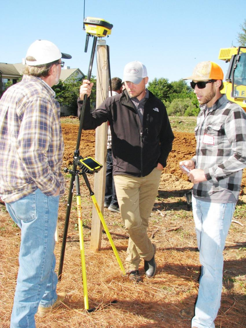 Construction Laser's Jay Allen (C) provides a complete demonstration of the Leica ICON GPS 70 T tilt rover to Kendal Hibner (L) and Wesley Hibner of Hibner Earthworks, Lewisville, Ga.