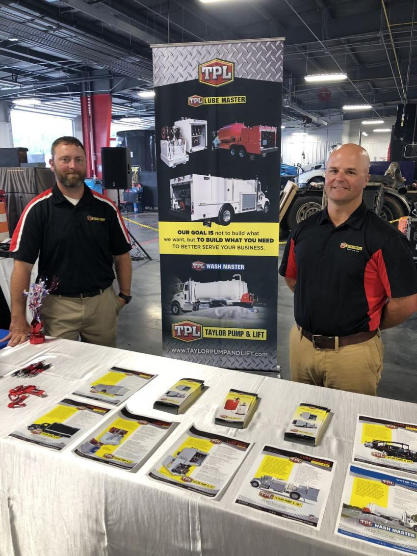 Nathan Gue (L) and Mitch Queen, both of Taylor Pump & Lift, had information ready on their Lube Master service trucks and other items.