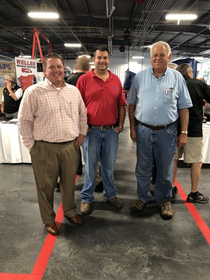 Matt Broday (L) of The Larson Group welcomes Richard and Rick Sowers of Sowers Construction Company of Mount Airy, N.C., to the grand opening.